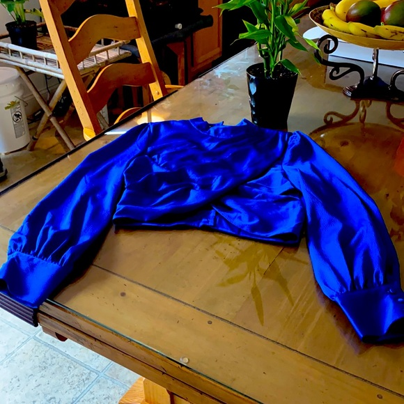 Might night Blue Bebe blouse size 8. New